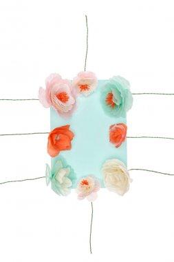 Decorative handmade flowers arranged around blank card isolated on white stock vector
