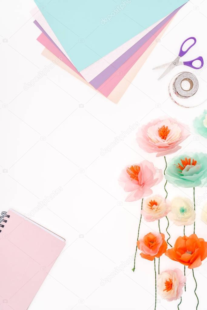 Top view of decorative flowers and stationery items isolated on white stock vector