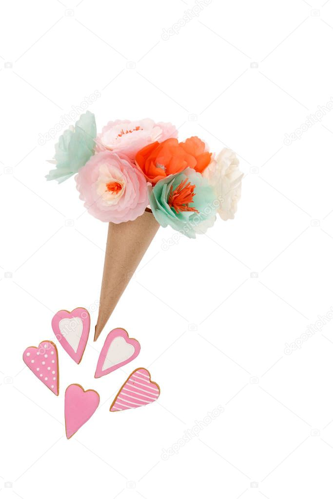 Handmade flowers in paper cone and heart shaped cookies isolated on white stock vector
