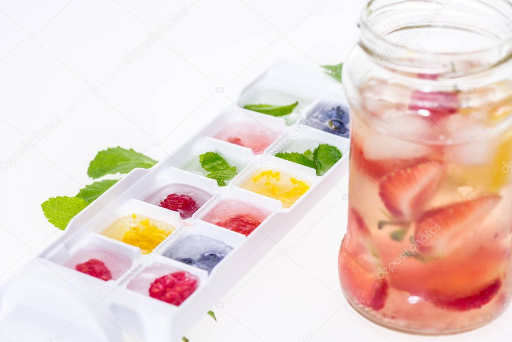 berries in ice cubes