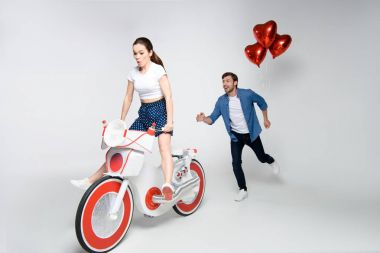 couple having fun with electric bike