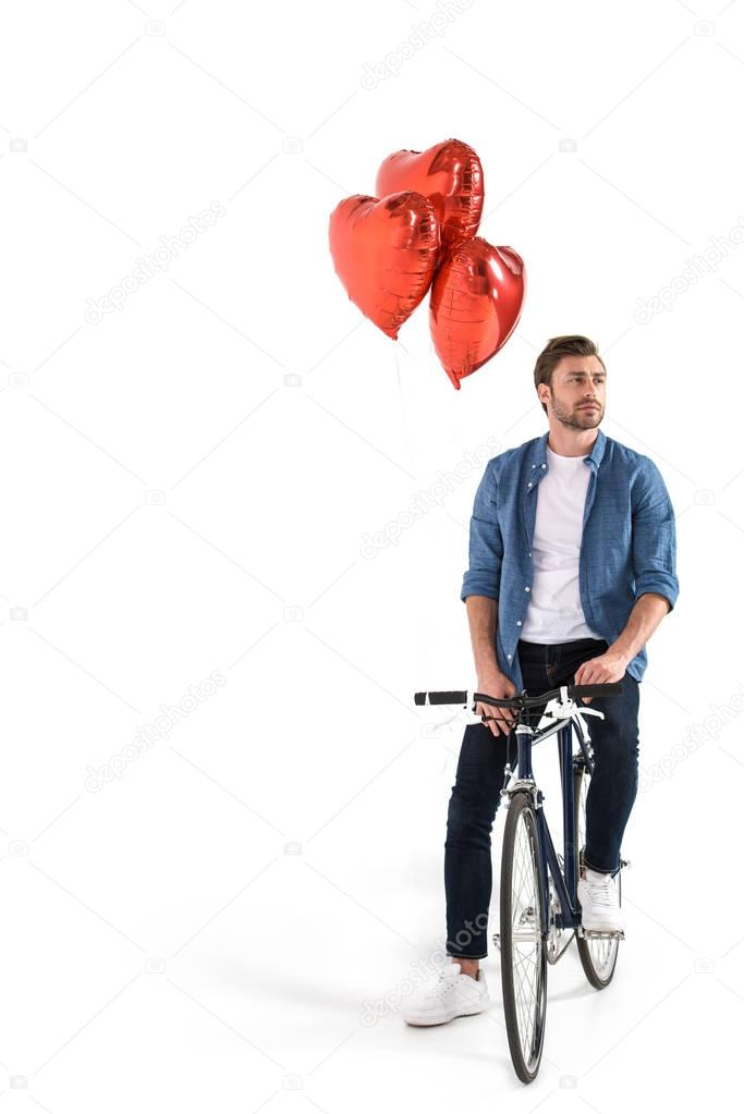 man with bicycle and balloons