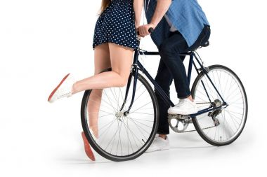Cropped view of young couple with bicycle, isolated on white stock vector
