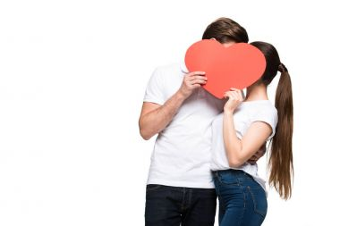 Young couple hugging and holding red heart, isolated on white stock vector