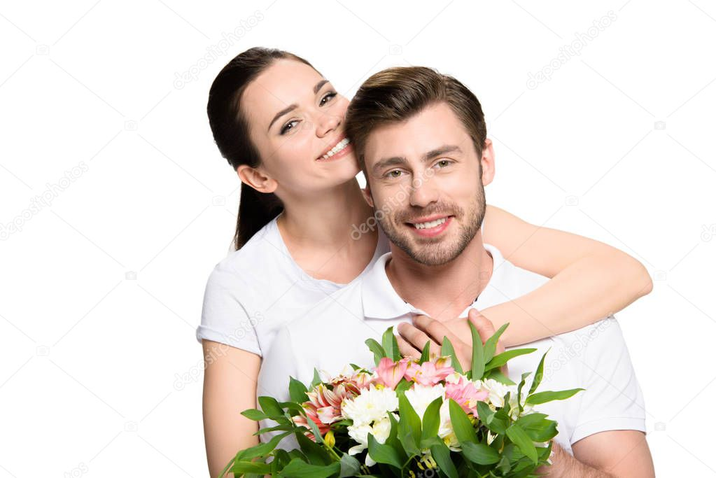 Couple with bouquet of flowers