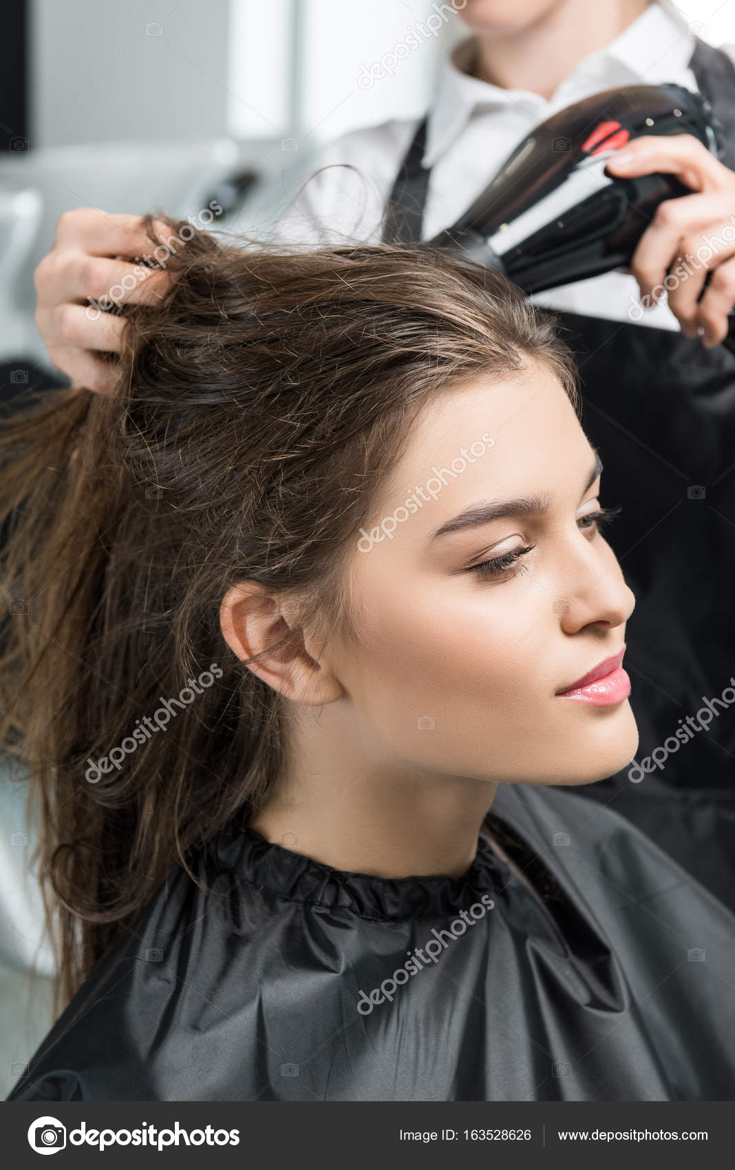 Hairdresser Drying Hair Of Woman Stock Photo Dimabaranow 163528626