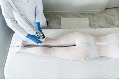 woman having procedure of lipomassage