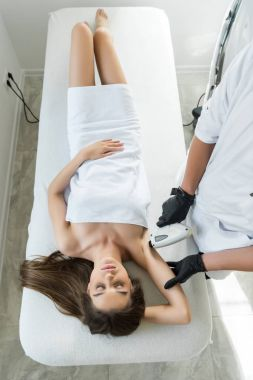 woman having laser epilation