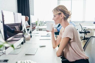 businesswoman using desktop computer