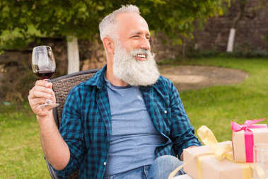 senior man with glass of wine