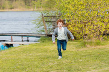 little boy running at countryside