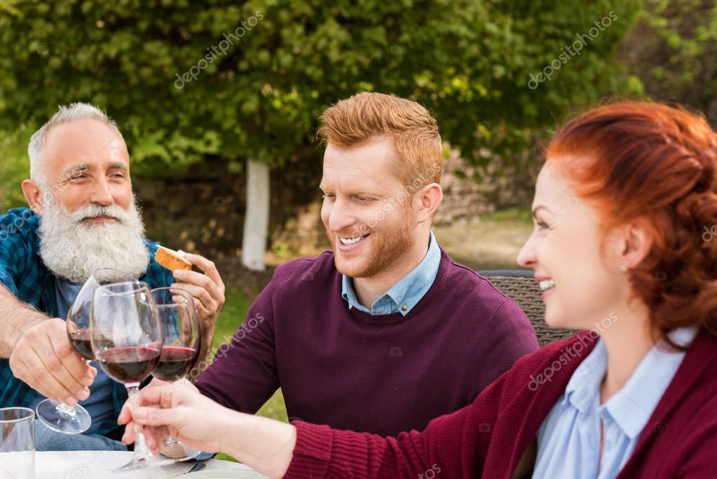family clinking glasses of wine