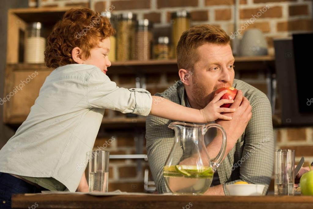 man eating apple