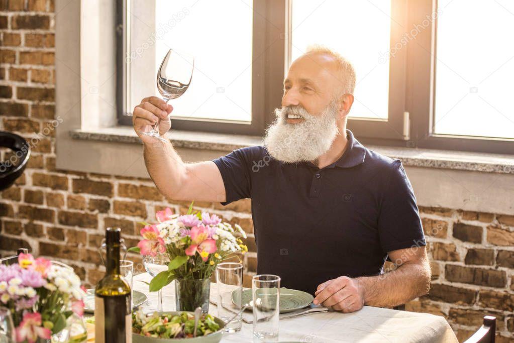 senior man with empty wine glass