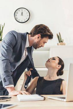 Secretery flirting with boss