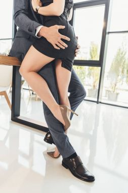 Couple making out in office