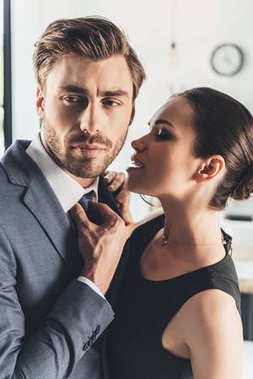 woman trying to kiss man in suit