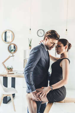 Couple embracing in office