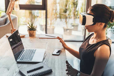 businesswoman using virtual reality glasses