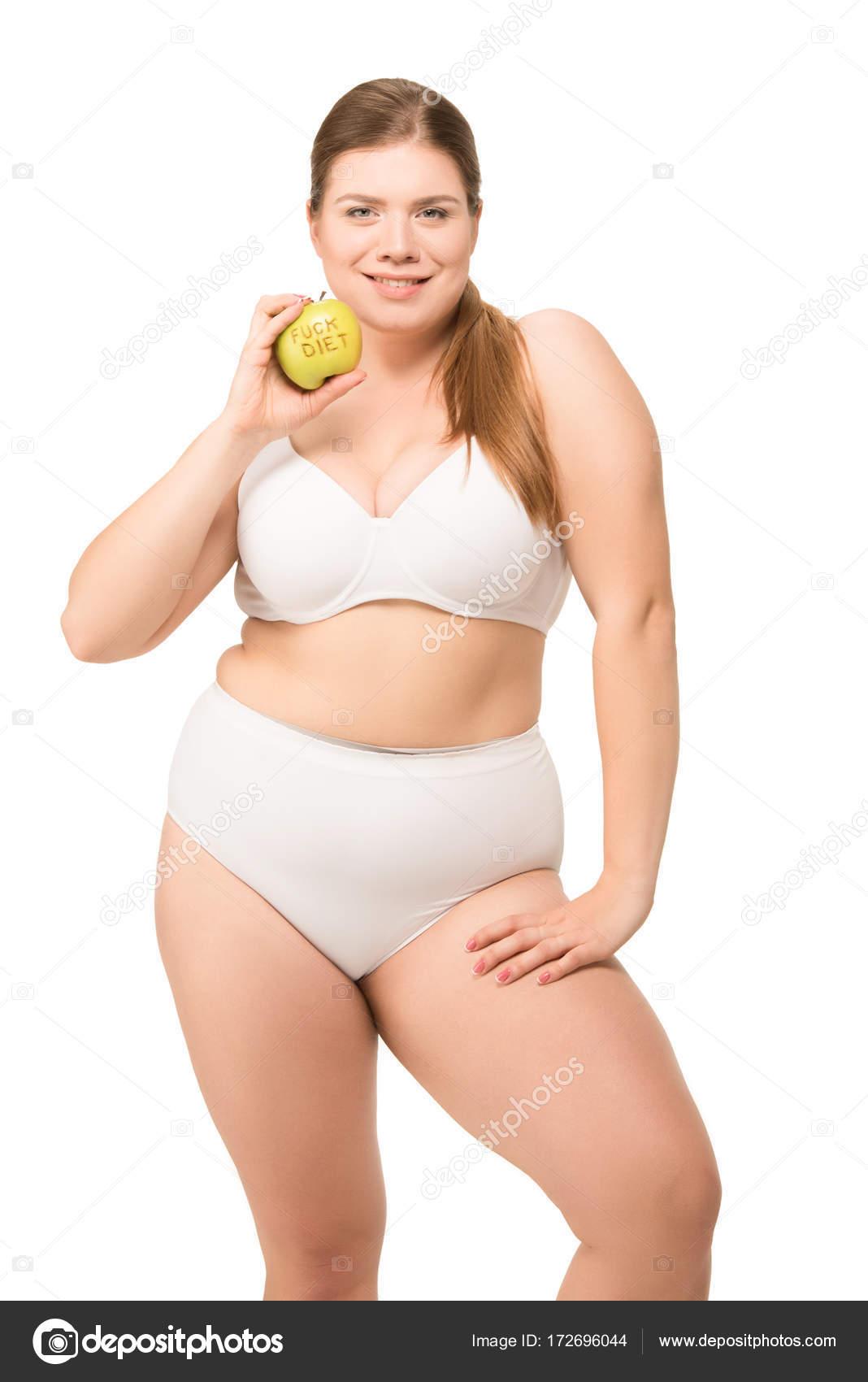 Grasso donna sorridente con mela - Foto Stock: Foto ...