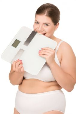 overweight woman biting scales