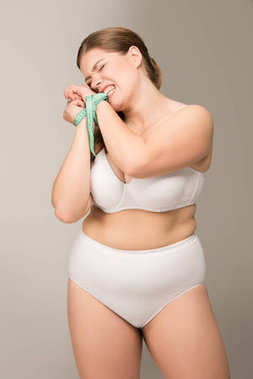 overweight woman bound with measuring tape