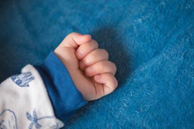 hand of sleeping toddler