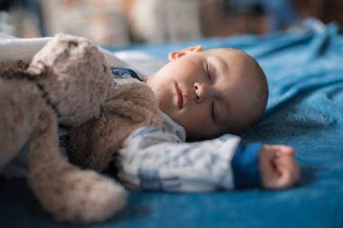 boy sleeping with teddy bear