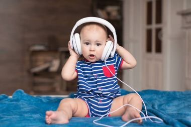 baby boy wearing white headphones