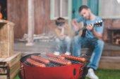 Fotografie hot dog sausages on grill