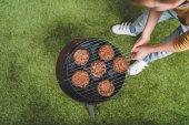 Fotografie boy cooking meat patties
