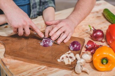 Father and son cutting vegetables