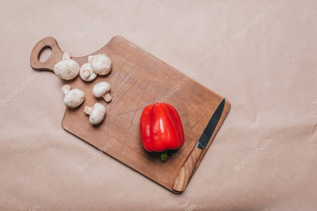 bell pepper and mushrooms on wooden board