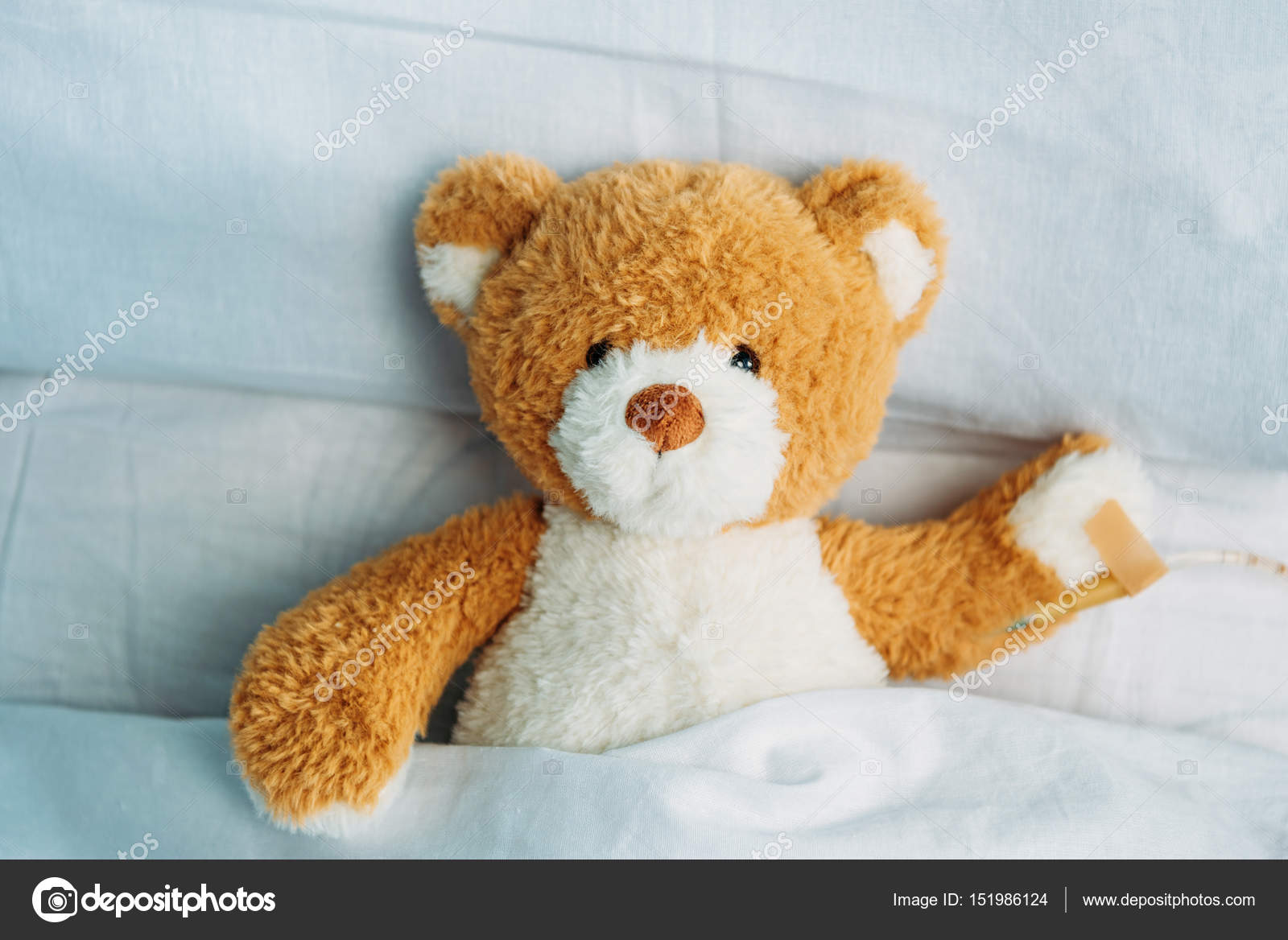 Teddy bear in bed stock photo alexlipa 151986124 close up view of cute teddy bear toy lying in bed with drop counter photo by alexlipa altavistaventures Choice Image