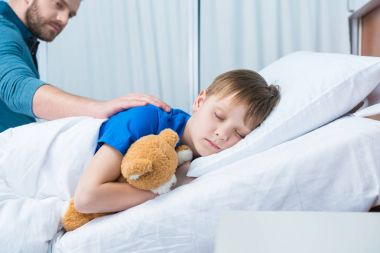 Dad and son in hospital