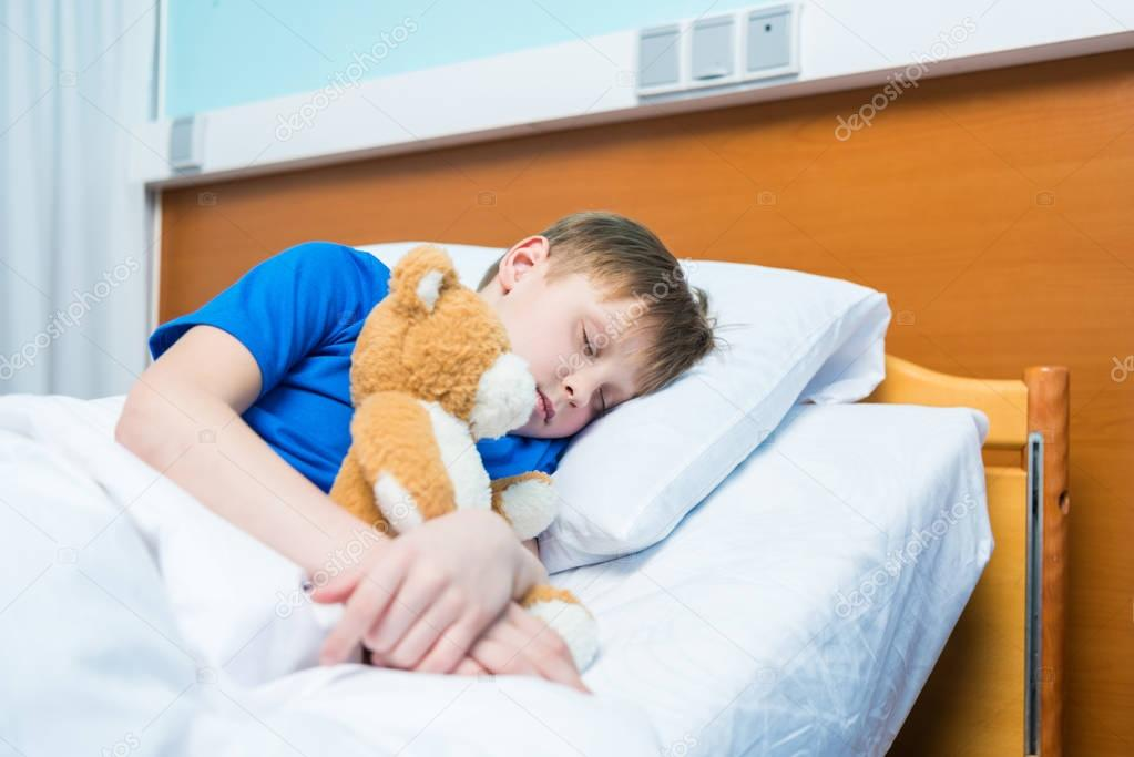 Little boy in hospital bed — Stock Photo © AlexLipa #151981282