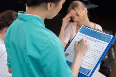 internist filling medical form