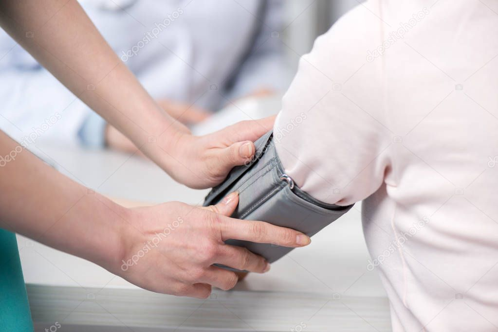 Doctor measuring blood pressure to patient