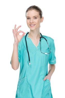 smiling nurse showing ok sign