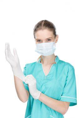 surgeon putting on medical gloves