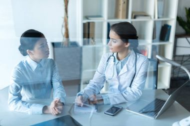 doctor talking with patient at office