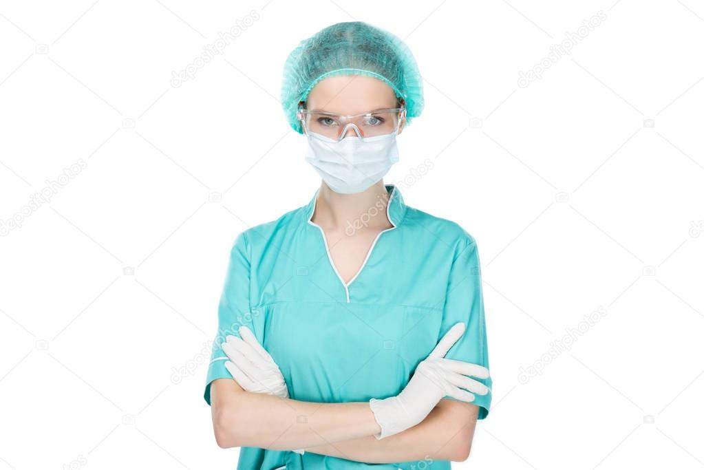 surgeon in medical mask with arms crossed