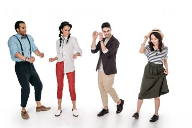 young stylish multiethnic friends dancing