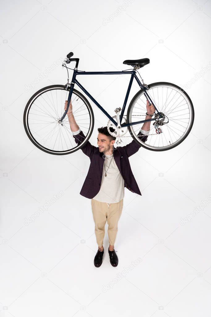 Stylish young man with bicycle