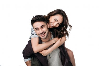 young smiling couple doing piggyback