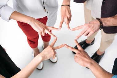 friends gathered hands in form of star