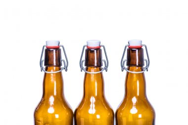 three sealed beer bottles