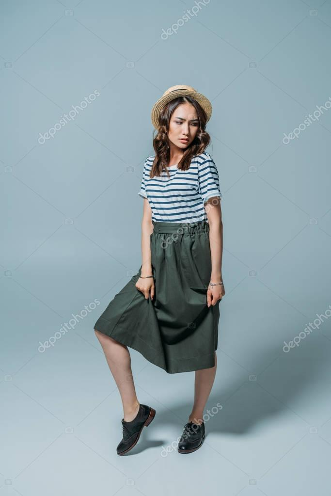 young woman posing in fashionable clothes