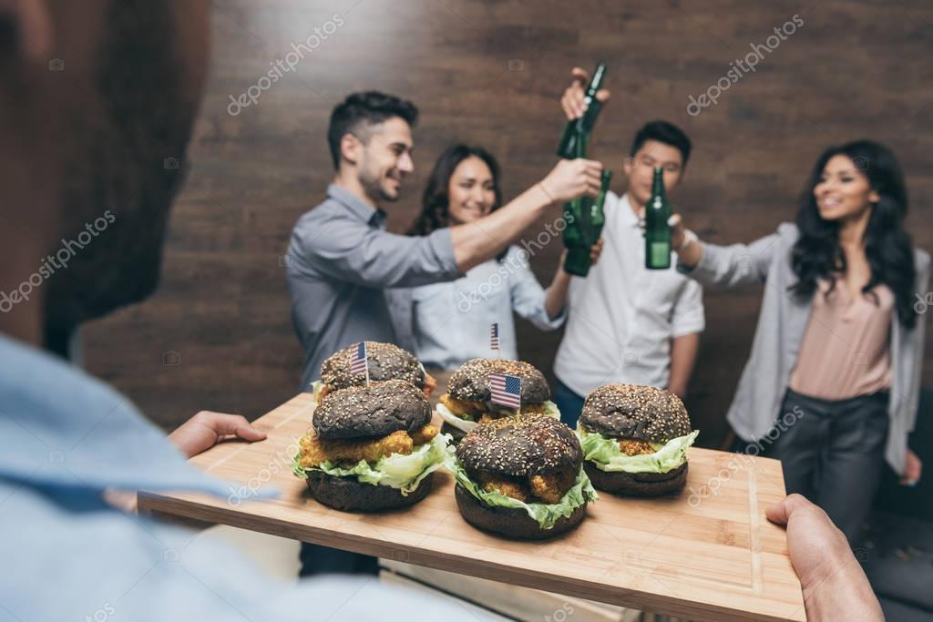 Young people eating hamburgers