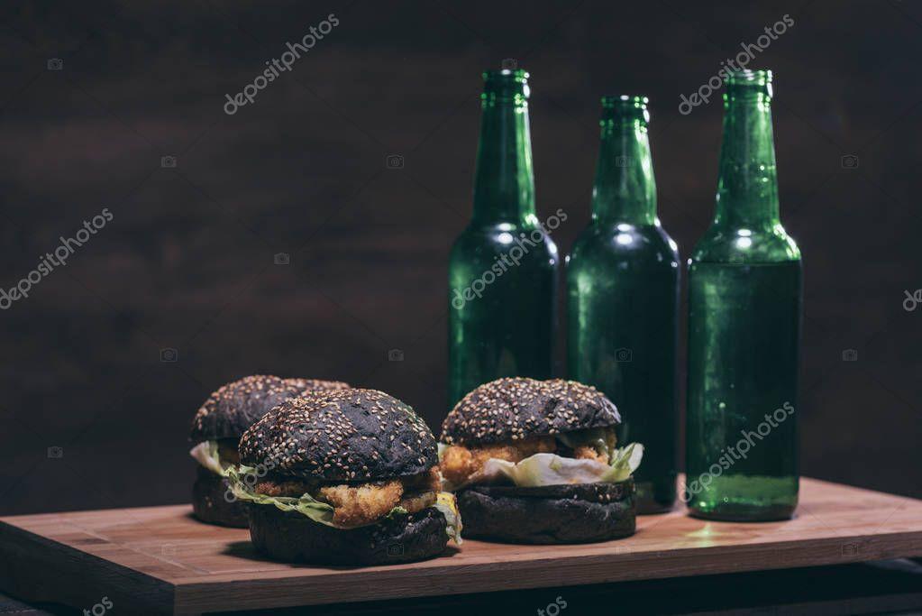 tasty burgers and bottles on kitchen desk